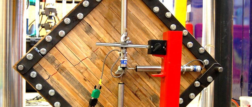 Cross laminated bamboo panel under test.