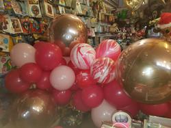 Organic balloon banner reds pinks