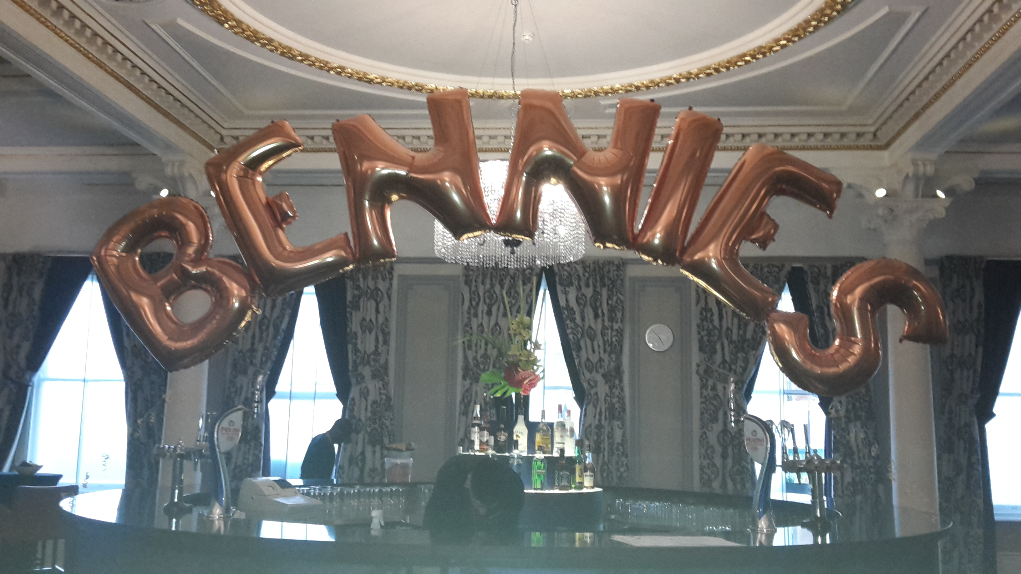 Balloon letter Arch over a bar