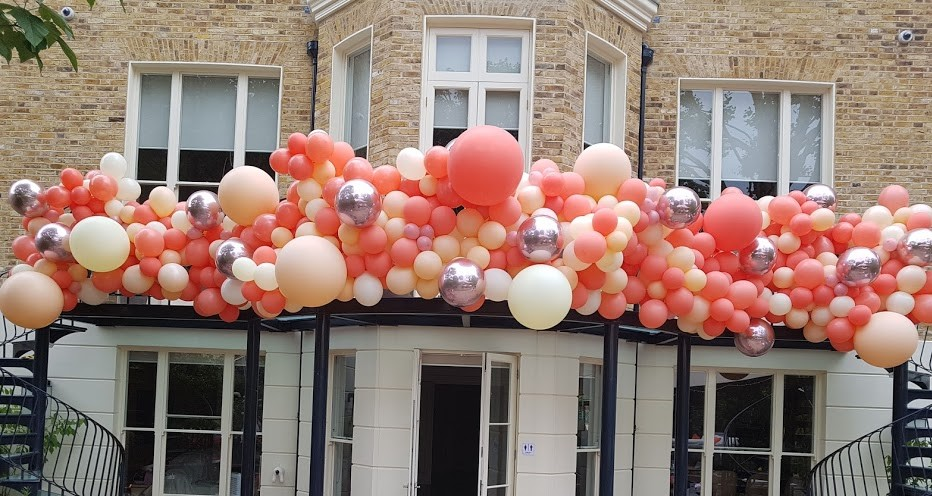 Balcony Balloon Arch in corals, blush an