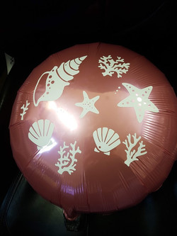 Printed foil balloon with sea shells
