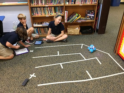 Students programming robots to complete a maze