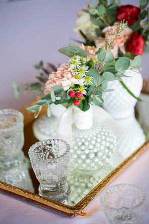 Mirrored centerpiece with candles and florals