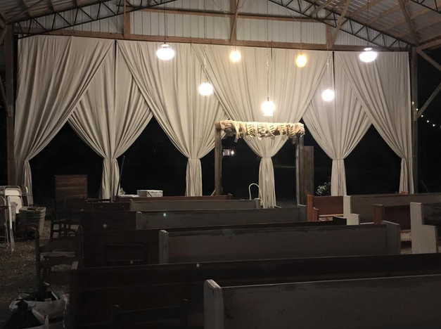 Ceremony backdrop with draped curtains