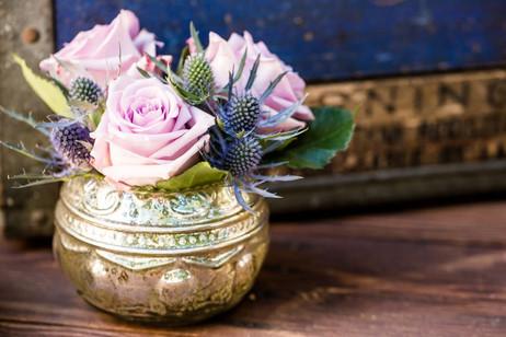 Floral centerpiece in mercury glass