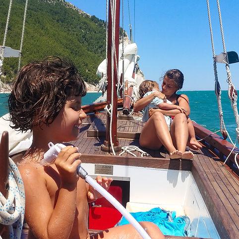 A family boat trip towards the Monte Conero