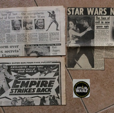 Newspaper pages and cuttings