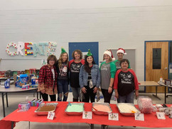 Our Hollis Academy team serving Christmas dinner at WES