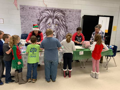 Our Hollis Academy team serving Christmas dinner at FHS