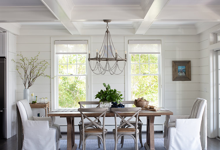 Beach House Renovation Eat-in breakfast area includes coffered ceiling, shiplap walls, rustic drape chandelier, wooden crossback chairs and custom upholstered seats.