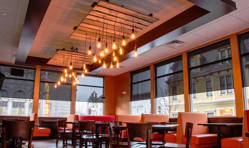 This Reclaimed Oak Pallet Custom Lighting Fixture with Clusters of Edison bulbs adds a Rustic Industrial touch to the Dining Area at Palace Pizza New Bedford.