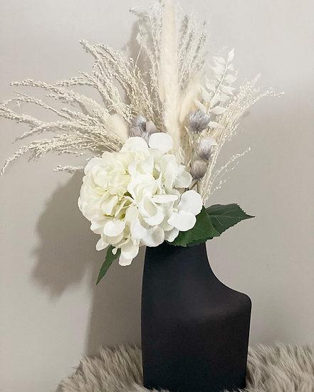 Ebony vase and floral arrangement