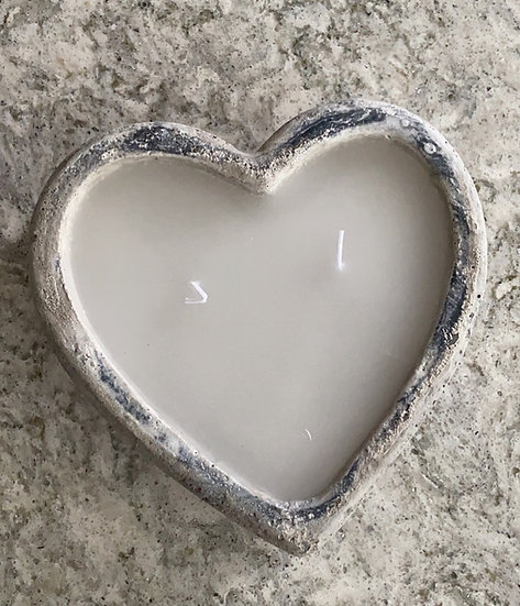 Double wick candle in a concrete rustic heart shaped pot