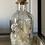 Thumbnail: Floral filled bottles