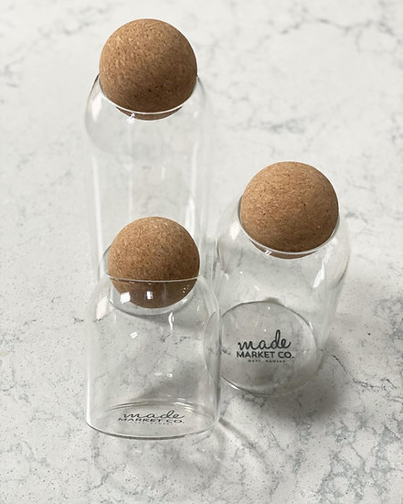 Glass canister with round cork lid