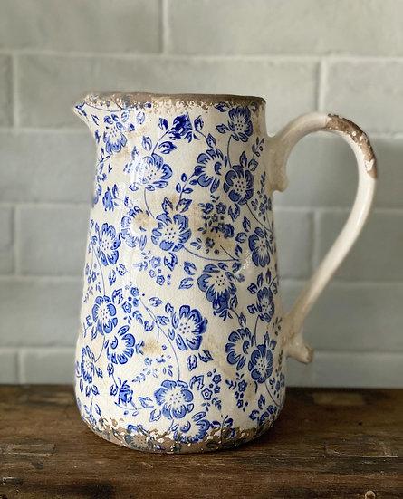 Distressed floral jug