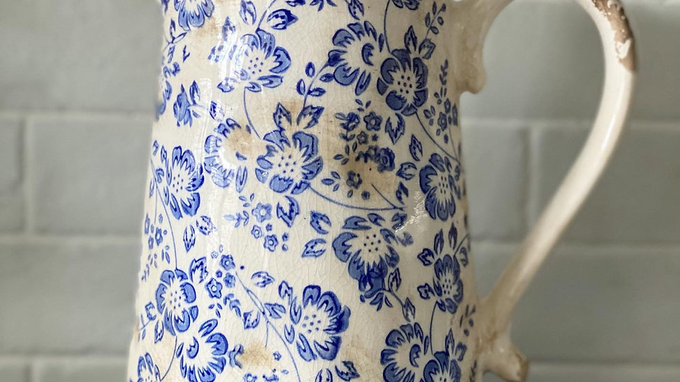 Distressed floral jug