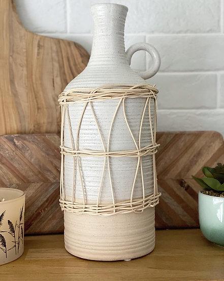Large rattan wrapped ceramic vase