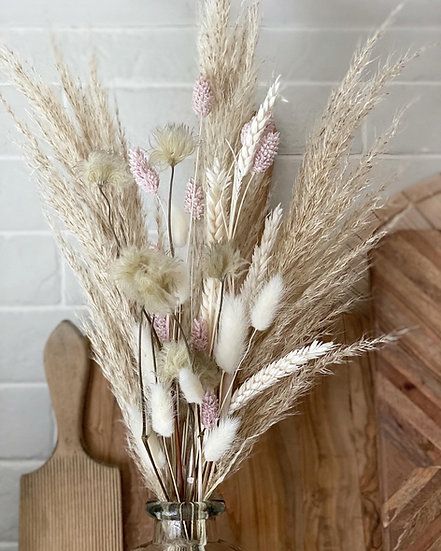 Fluffy pampas and clematis bouquet