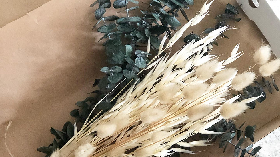 Dried bouquet of baby blue eucalyptus, tall bleached oats and natural bunny tail