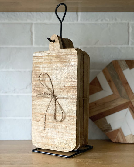 Hanging wooden boards on a stand
