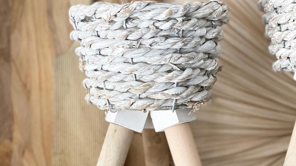 Smaller white woven planter on legs
