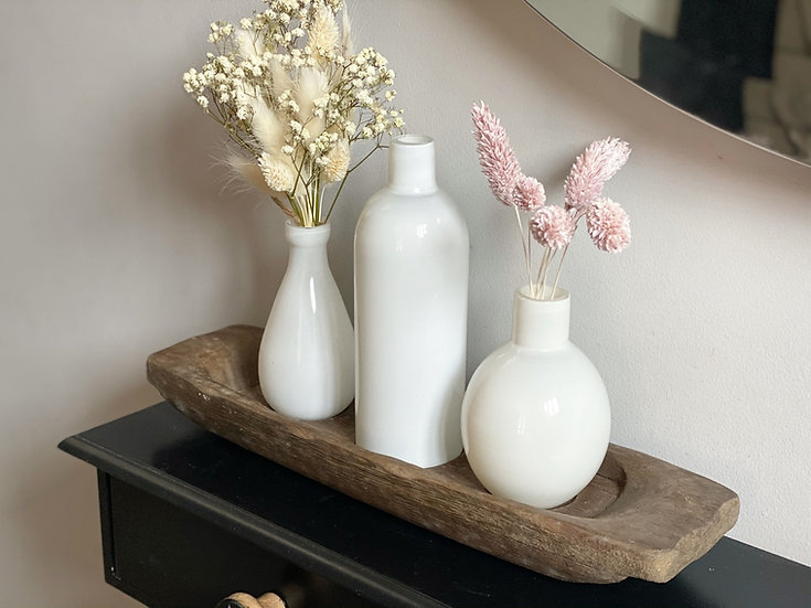 Trio of white bud vases on a rustic wooden base