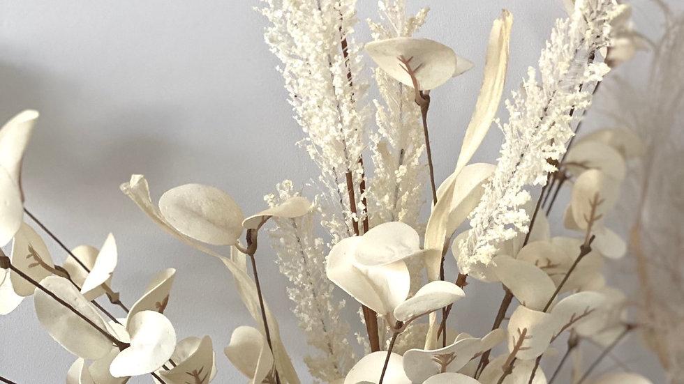 Faux cream leaf spray on a stem