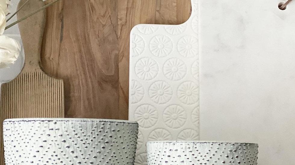 Textured white plant pots on feet