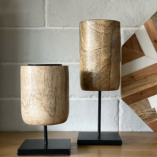 Taller mango wood candle holder on a stand