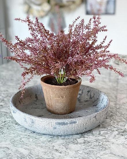 Faux erica (heather) bush in an aged terracotta pot