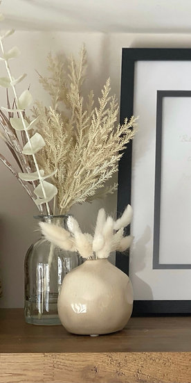 Faux floral arrangement in a glass vase