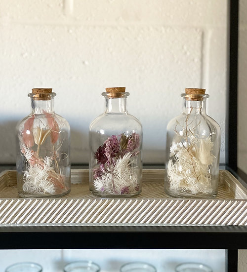 Floral filled bottles