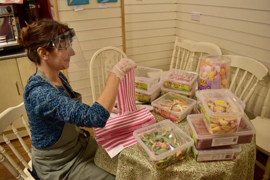 preparing bags of sweets