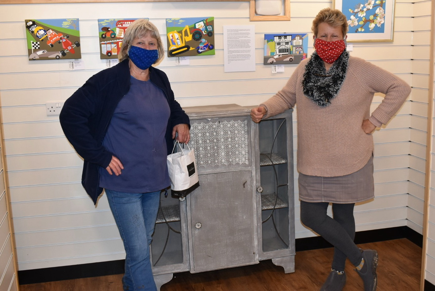 Annie and Julie, our window dressers and artwork organisers!
