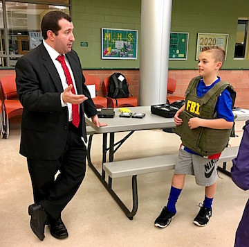 FBI Special Agent Michael A. Petronella with fourth-grader Joseph Conway