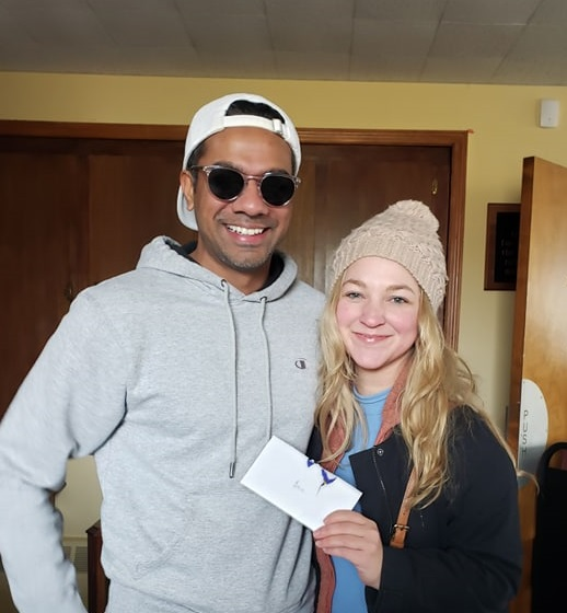Amber, on right, with a friend turned over the card to Congregation Kehilat Shalom on Dec 26.