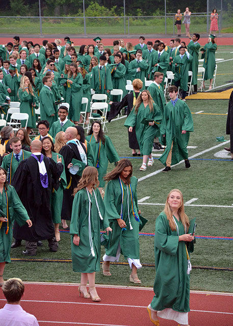 Graduates leave the field
