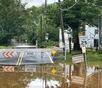 Tropical Storm Henri Floods Roads, Stalls Cars