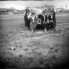 Standing in front of a decorated car for the parade  - Lewis Field.  (c. 1922)
