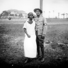 Couple standing in Lewis Field.  (c. 1922)