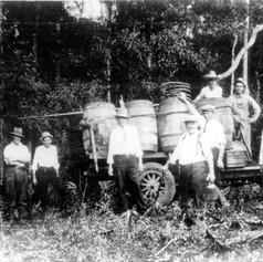 Men surrounding a capture moonshine still