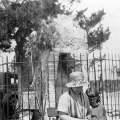 Woman and child sitting by the Old Spanish Chimney