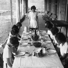 Young campers saying grace before lunch at the FERA camp for unemployed women - Anastasia Island, Florida (1934)