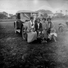Sitting on a decorated car for the parade.  (c. 1922)
