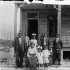 The Demps Family outside their home. (c. 1922)