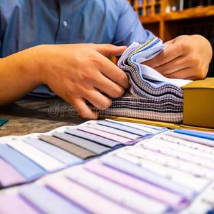 tailor-choosing-fabric-swatch-his-custom