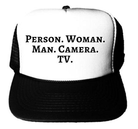Person Woman Man Camera TV Trucker Hat