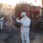 A technician in PPE working on thermal remediation of chromium contaminated soil