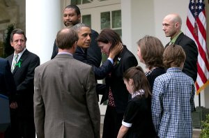 President Obama comforts Newtown families.